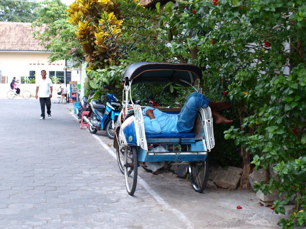 Becak driver having a rest after hard day work